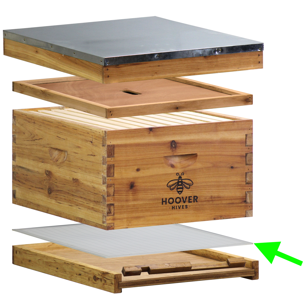 An Exploded View Of A Beehive Showing The Pieces Separated Apart. The Queen Excluder Is Placed Above The Solid Bottom Board