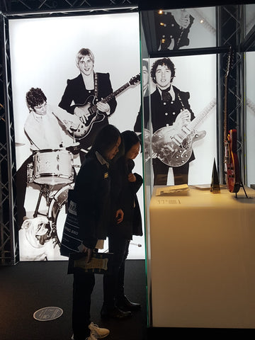 two-women-looking-guitar-used-Easybeats-Maton-exhibition