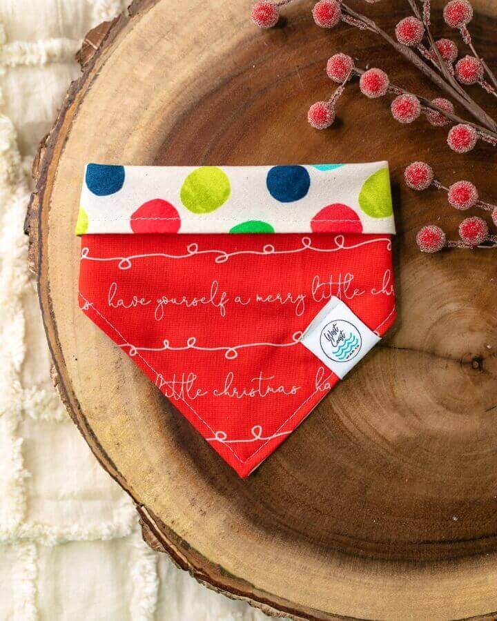 "Red reversible dog bandana with ""have yourself a merry little christmas"" text"