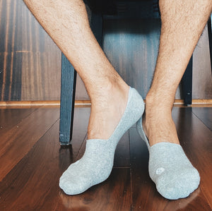 Photo of man's legs and feet wearing Skinnys padded-heel socks