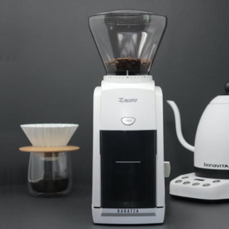 Baratza Encore is a white colored grinder with a conical shaped transparent bean hopper at the top.