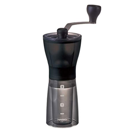 Hario Ceramic Mini Mill Grinder is compact in size and has a transparent black body at the bottom and a black body at the top.