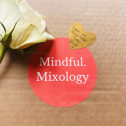 """A box of Mindful Mixology cocktails, with a heart shaped sticker on the front reading """"Open me on Valentine's Day. Love Jack. x"""""""