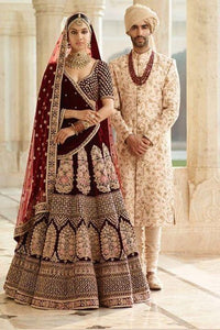 Beautiful Maroon Designer Partywear Embroidered Lehenga .