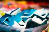 Gummy sharks are just one of the many types of gummy candies that can be used in edible excavations