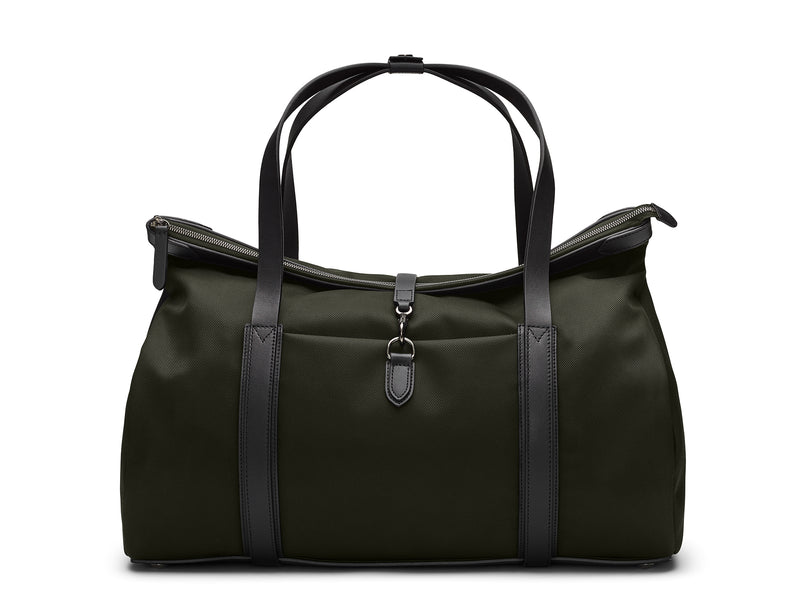 Measurements:    L: 52  H: 29 W: 18 (27)  cm Body: Waterproof heavy-duty ballistic nylon Fabric Composition: PA 64% PL 19%  PU 17% / 862 gr./rm. Trimmings: Black custom developed vegetable tanned full-grain bridle leather  Lining: 100% cotton in grey colour Hardware: Gunmetal - Solid brass with varnish protection Zipper: Hand polished YKK Excella Art. No. MS307320 The refined little brother of M/S Explorer boasts the same DNA but with a different shape and detailing ideal for weekend trips