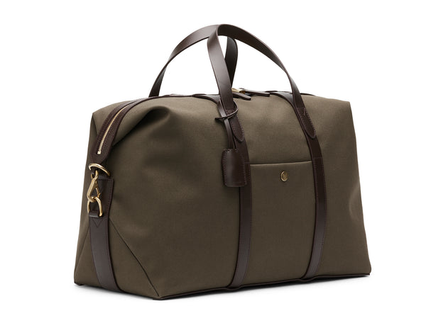 Measurements:  L: 47  H: 29  W: 24cm Body: Tight-woven cotton canvas Fabric composition: CO 94% PU 4% PC 2% - 709 gr/rm Trimmings: Dark brown custom developed vegetable tanned full-grain bridle leather Lining: 100% cotton in army colour  Hardware: Solid brass with varnish protection  Zipper: Hand polished YKK Excella travelling cosmopolitan, the M/S Avail is our latest take on a weekender that seamlessly merges style and function in a compact shape with enough room to easily hold a weekend