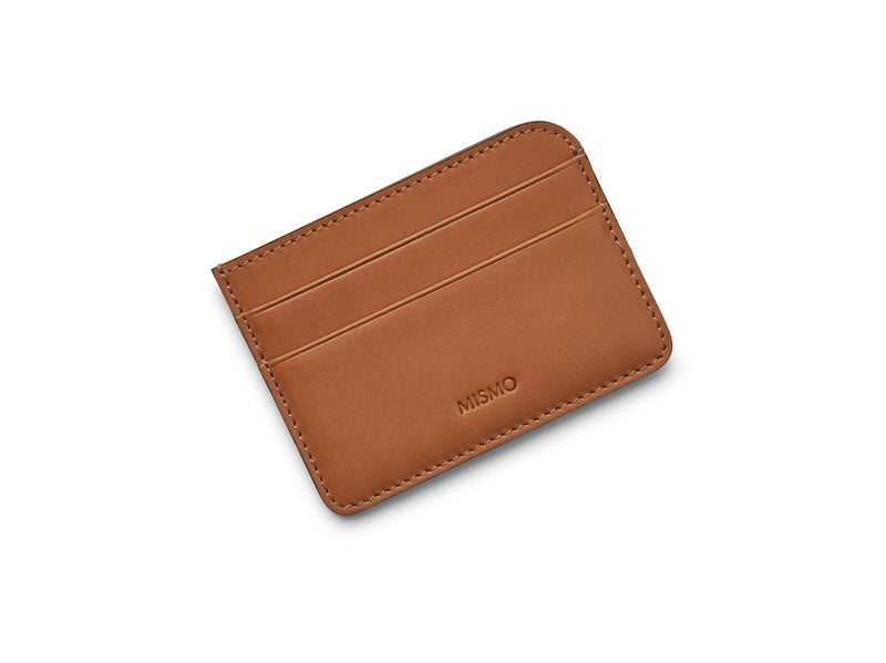 A neat little double-sided cardholder with two slots for credit cards to the front and back. A middle compartment leaves room for receipts and notes. Measurements: L: 10   H: 7,3   W: 0,3cm Body: Vegetable tanned full-grain cow leather Leather trimmings: Vegetable tanned full-grain cow leather Lining: Cotton/nylon stripe lining in off white/anthracite Art. No. FG120220
