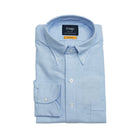 Light Blue Oxford slim fit shirt with button-down collar. Classic and very versatile shirt for casual dressed up days. You can wear it with a tie but it sure is at it's best without one.  A stable for every mans wardrobe.   100% Cotton. Handcrafted in Somerset, UK.  Slim Fit Button-down collar with soft feel Box pleat Single round one button cuff Point pocket Mother of Pearl buttons 100% cotton Made in England