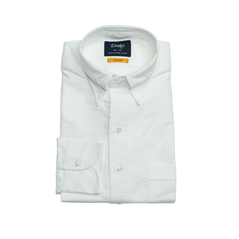 White Oxford slim fit shirt with button-down collar. Classic and very versatile shirt for casual dressed up days. You can wear it with a tie but it sure is at it's best without one.  A stable for every mans wardrobe.   100% Cotton. Handcrafted in Somerset, UK.  Slim Fit Button-down collar with soft feel Box pleat Single round one button cuff Point pocket Mother of Pearl buttons 100% cotton Made in England