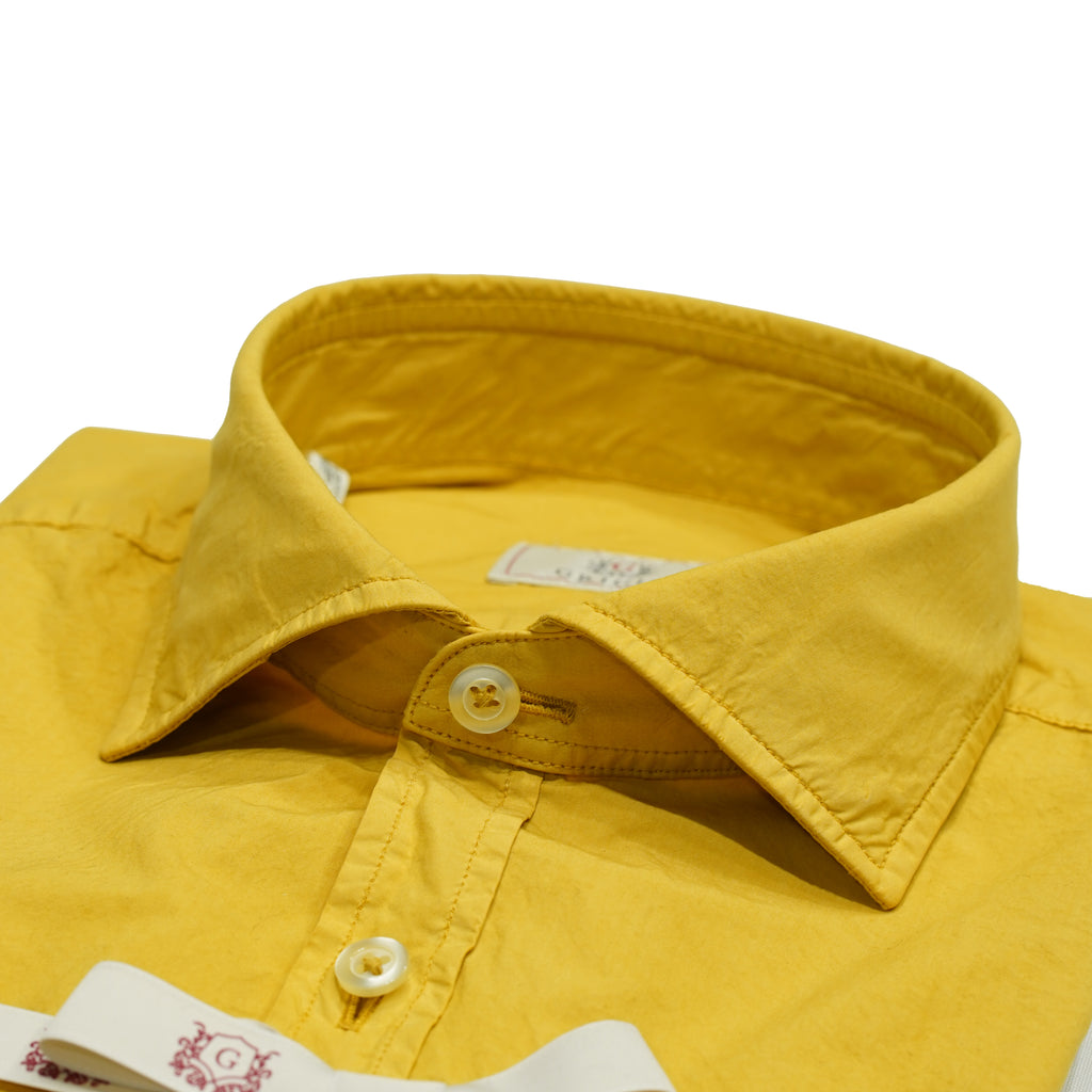 Grigio Garment dyed Shirt. Extremely comfortable quality with soft collars that fit the garment dyed look perfectly. Loosen your tie, roll up the sleeves and you are all set for the summer.  100% cotton Garment dyed Long Sleeves Slim fit Style: Oregon Col: Yellow 013915 4482 120 G-GCB-GCD Art.32994-1 Made in Romania