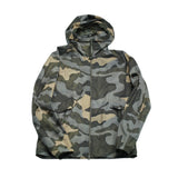 Lightweight hooded PRO-TEK windbreaker with camo pattern.  C.P. lens. CP Company´s PRO-TEK fabric is a high-performance stretch woven polyester with WR coating, developed specifically to combine the weight and comfort of a sweatshirt but with the protective functions of an outer-layer.  Lightweight Packable Water resistant Windproof Breathable Stretch 100% polyester 08CMOW192A 005744A Fits true to the size, designed to be a little loose fit
