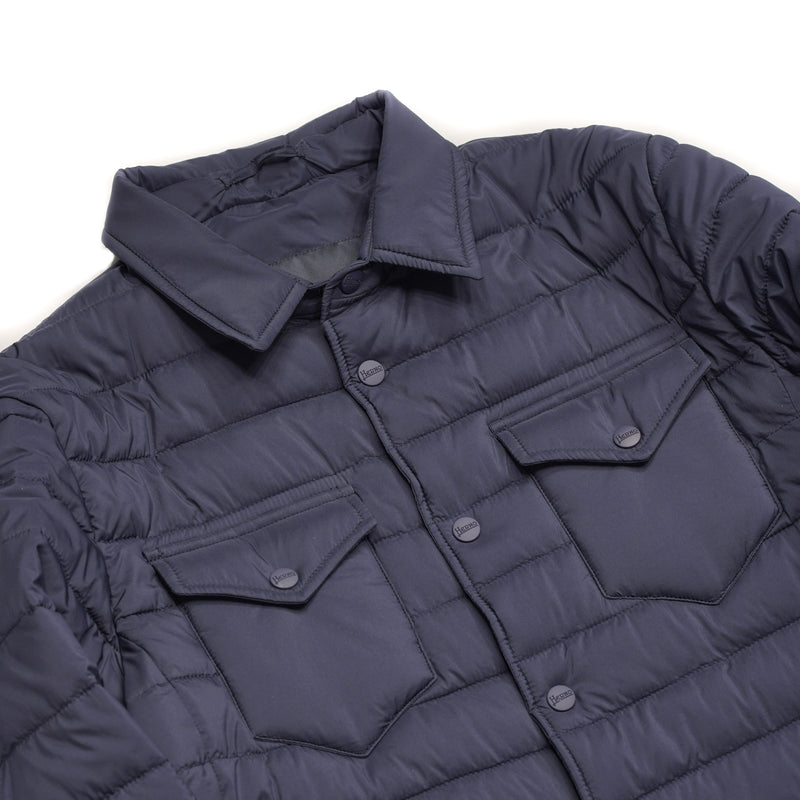 Snap buttons 4 pockets outside, 2 inside Alternative Down Light insulation Water repellent Breathable External layer 100% Polyamide Internal padding 100% Polyester PC004ULE 19288 9250 Made in Romania Herno In-Tech™ Alternative Down Overshirt in Blue. Lightly padded with thermal insulation