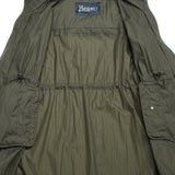 Ultra light water repellent and windproof parka. It can be packed in a pocket inside back yoke (transforms into a over shoulder bag) and strapped over your shoulder with a strap attached. Extremely convenient outerwear piece to carry along where ever your day takes you.  Water repellent  Windproof Unlined Adjustable waist Zip closure Packable inside a pocket in the back 100% Polyamide PA0070U 12314 9290  Color: Green