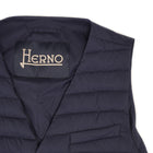 Herno In-Tech™ Alternative Down Waistcoat in Blue. Great piece for layering.A true must have for every modern gentleman.  Wear it under jacket or over a knit. Great for traveling as it packs small and weighs almost nothing.   In-Tech™ Alternative Down Water Repellent  Breathable Light Insulation 5 buttons  3 pockets  Adjustable back External layer 100% Polyamide Internal padding 100% Polyester  PC0039U 19288 9201 Made in Romania