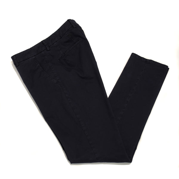 This kind of cotton trouser are one of the corner stones of every man's casual wardrobe, the slim fit chino. These are made in a slim cut and garment dyed and washed which give the trousers a beautiful and unique colour. These are the trousers that go with everything from t-shirts to jackets or even with both. 98% Cotton 2% Elastan Color: Navy Button closure with zippered fly Slanted front pockets and two back pockets Model: SC Reg Article: ts0001x Made in Martina Franca, Italy