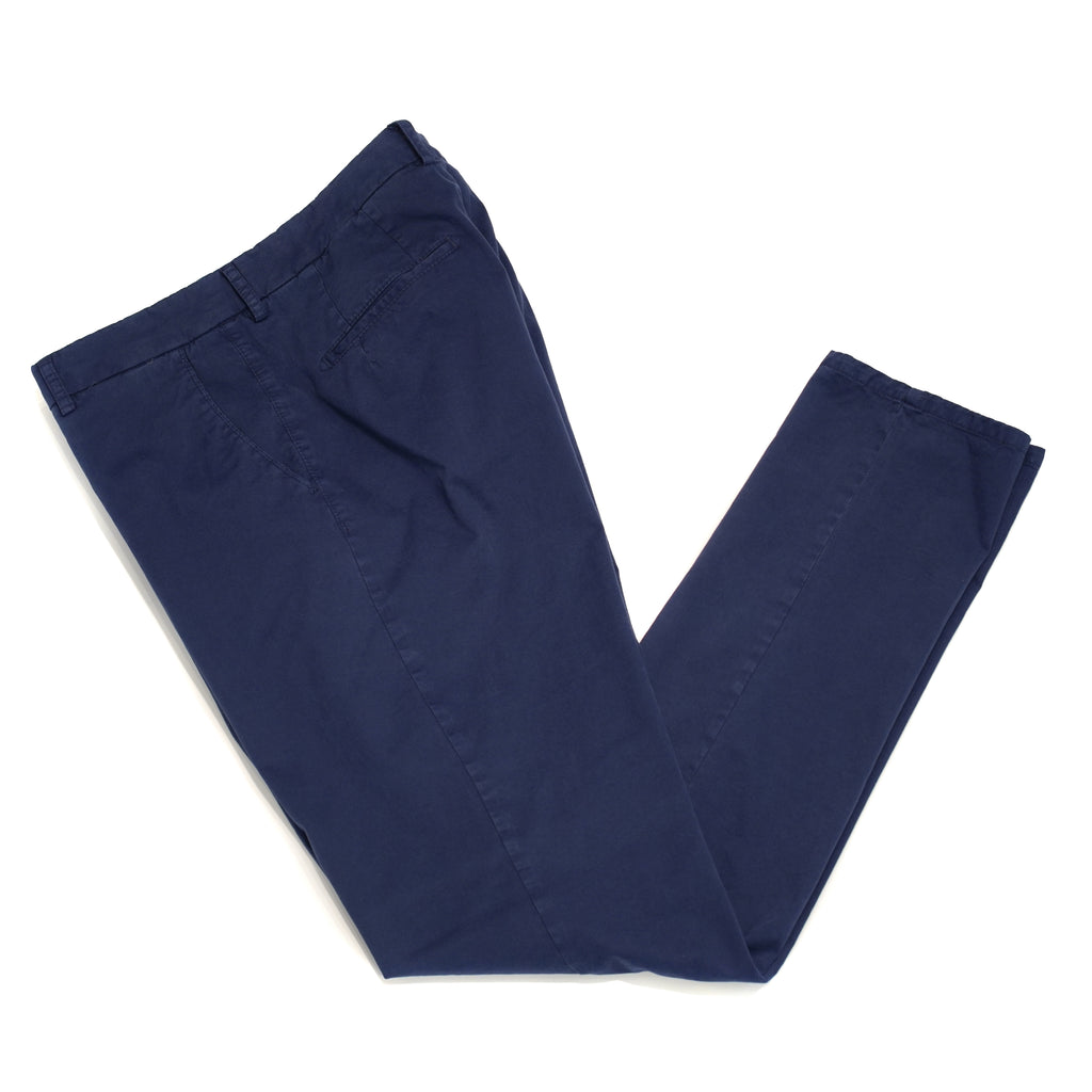 This kind of cotton trouser are one of the corner stones of every man's casual wardrobe, the slim fit chino. These are made in a slim cut and garment dyed and washed which give the trousers a beautiful and unique colour. These are the trousers that go with everything from t-shirts to jackets or even with both. 98% Cotton 2% Elastan Color: Blue Button closure with zippered fly Slanted front pockets and two back pockets Model: SC Reg Article: ts0001x Made in Martina Franca, Italy