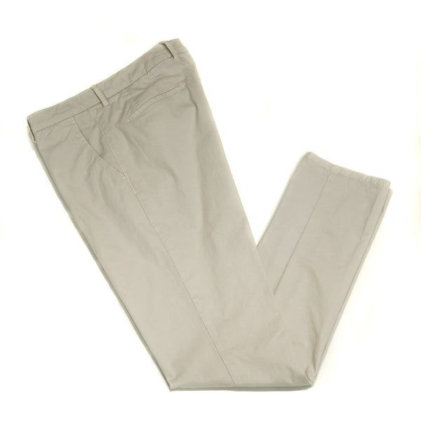 This kind of cotton trouser are one of the corner stones of every man's casual wardrobe, the slim fit chino. These are made in a slim cut and garment dyed and washed which give the trousers a beautiful and unique colour. These are the trousers that go with everything from t-shirts to jackets or even with both. 98% Cotton 2% Elastan Color: Light Gray / White Button closure with zippered fly Slanted front pockets and two back pockets Model: SC Reg Article: ts0001x Made in Martina Franca, Italy