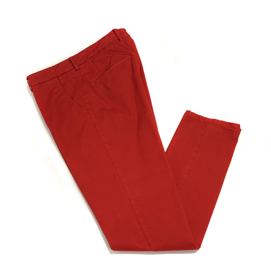 This kind of cotton trouser are one of the corner stones of every man's casual wardrobe, the slim fit chino. These are made in a slim cut and garment dyed and washed which give the trousers a beautiful and unique colour. These are the trousers that go with everything from t-shirts to jackets or even with both. 98% Cotton 2% Elastan Color: Red  Button closure with zippered fly Slanted front pockets and two back pockets Model: SC Reg Article: ts0001x Made in Martina Franca, Italy
