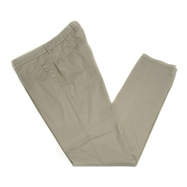 This kind of cotton trouser are one of the corner stones of every man's casual wardrobe, the slim fit chino. These are made in a slim cut and garment dyed and washed which give the trousers a beautiful and unique colour. These are the trousers that go with everything from t-shirts to jackets or even with both. 98% Cotton 2% Elastan Color: Light Beige Button closure with zippered fly Slanted front pockets and two back pockets Model: SC Reg Article: ts0001x Made in Martina Franca, Italy