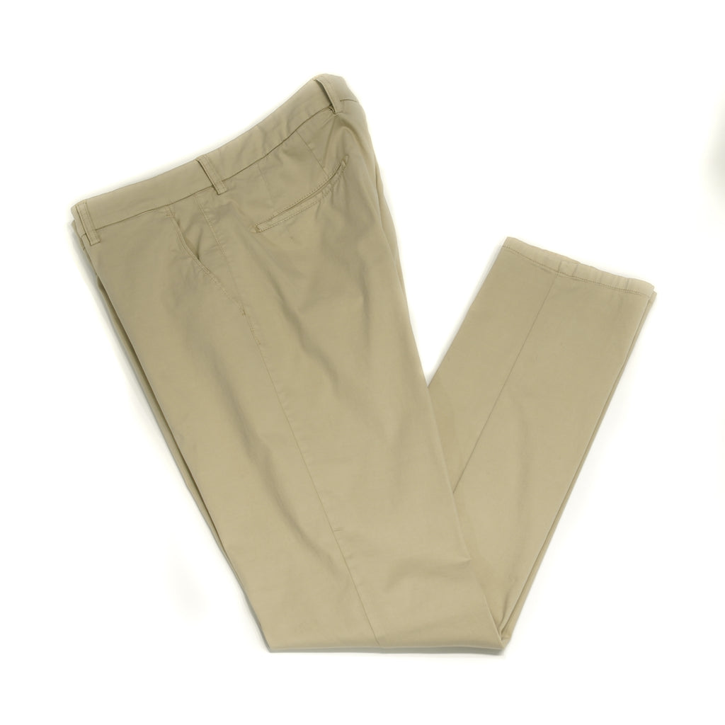 This kind of cotton trouser are one of the corner stones of every man's casual wardrobe, the slim fit chino. These are made in a slim cut and garment dyed and washed which give the trousers a beautiful and unique colour. These are the trousers that go with everything from t-shirts to jackets or even with both. 98% Cotton 2% Elastan Color: Beige Button closure with zippered fly Slanted front pockets and two back pockets Model: SC Reg Article: ts0001x Made in Martina Franca, Italy