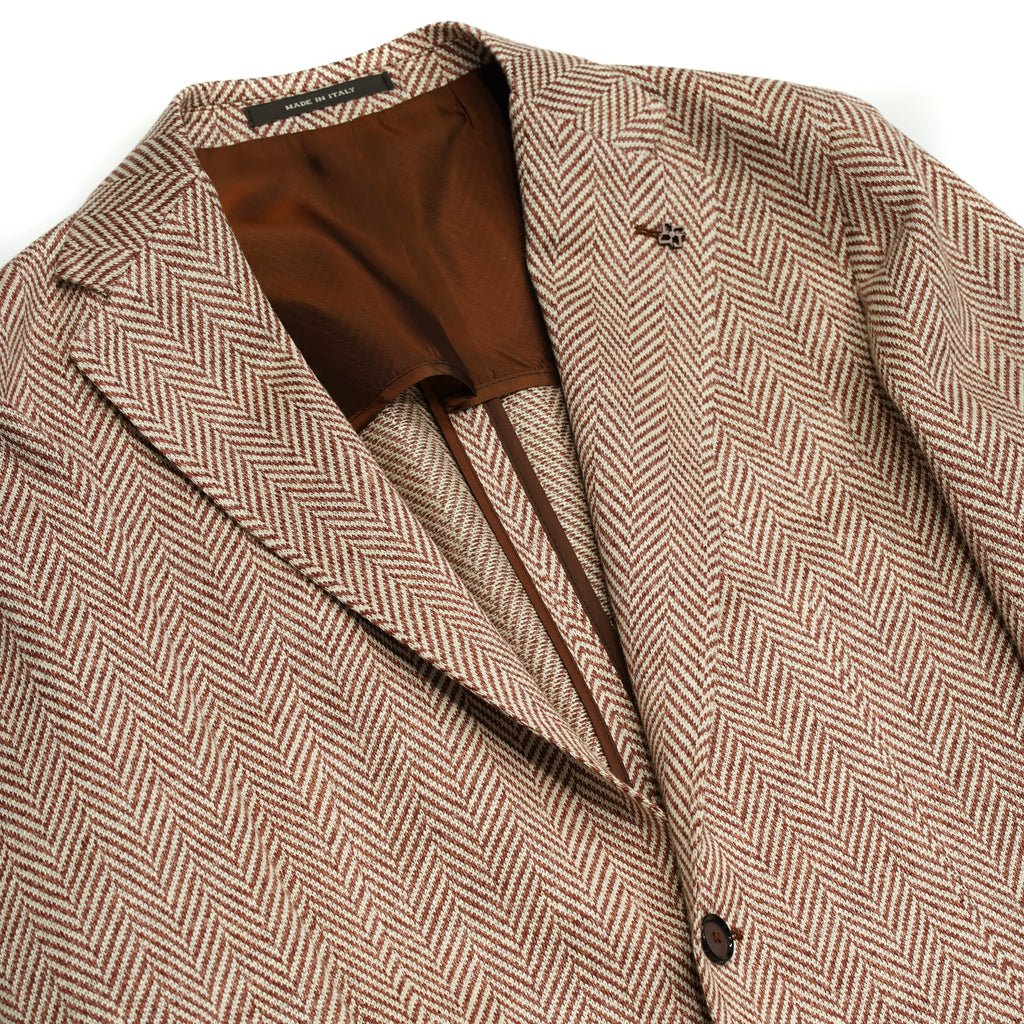 Linen Jersey summer jacket Herringbone pattern Unlined Unconstructed shoulder 2 Buttons Side vents Notch lapel Patch pockets Composition: 100% Linen Color: Orange/Neutral Modello: 1SMJ22K Article: 57ZEJ153 Colore: K1040 Made in Italy Tagliatore
