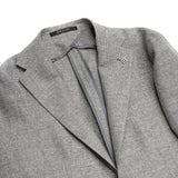 Wool/Linen mix summer jacket Hopsack Unlined Unconstructed shoulder 2 Buttons Side vents Notch lapel Patch pockets Composition: 58% Wool, 42% Linen Color: Silver Modello: G-PL22K Article: 47UEG076 Colore: A287 Made in Italy Tagliatore