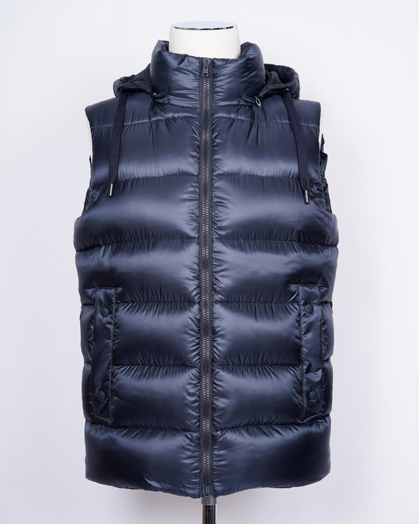 Herno Down Waistcoat. A perfect garment agains cold weathers. Wear it over a knit for a extra warmth, or layer it over jacket as the Italians do.  Down filling (90% down, 10% feather)  2 way zip in front Detachable hood 2 pockets in front 2 pockets inside External layer 100% Polyamide with wool detailing PI0639U 12020 9200 Made in Romania
