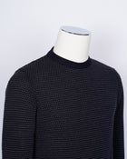 Crew neck 100% merino wool micro spotknit from G.R.P. Firenze. Spotknit is already a icon quality for G.R.P. and is a stable in our knitwear range.  100% Merino Wool  Long sleeves Art. SF TEC 2/14 BICOLOR  Col. Blu Notte / Antracite