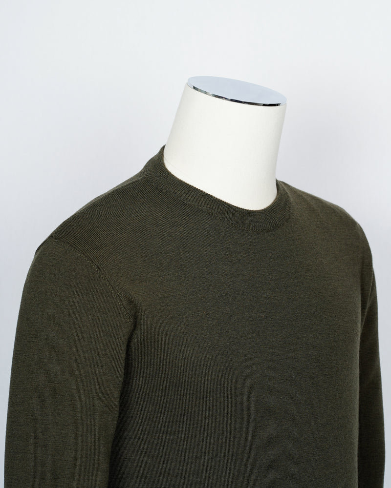 Crew neck 100% merino wool knit from G.R.P. Firenze. Straight hem and sleeve. Quite heavy quality and clean lines for calm elegance.   100% Merino Wool Long sleeves Art. SF TEC 55 Col. Verde / Green G.R.P. have their own size standards. Please see below:  III equals 46  IV equals 48  V equals 50  VI equals 52  VII equals 54  VIII equals 56