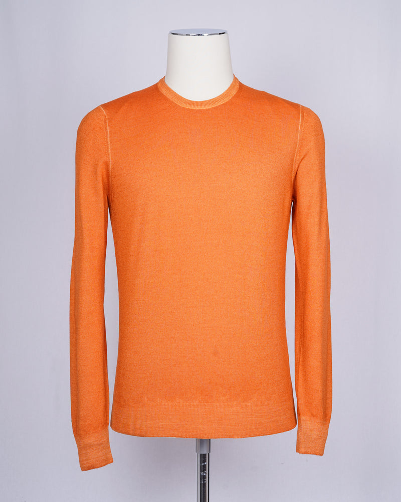 Gran Sasso Vintage merino wool knit. It has been garment dyed to achieve nice vintage look. This means it has more vivid compared to yarn dyed knitwear.   Vintage Merino is a core quality in our Gran Sasso collection. We offer a lighter quality for spring/summer and heavier for autumn/ winter season.   Crew neck 100% summer merino wool Vintage washed (garment dyed) Ribbed hem and cuffs Fashion fit Article: 57167/28412 Colore: 410 / Arancia, Orange  Made in Italy