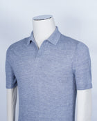 Gran Sasso Linen Polo shirt in Blue melange color. Elegant Capri collar gives this shirt  a bit dresser look. This kind of linen knits are highly comfortable for summer. Guaranteed to keep you fresh and cool on hot days and nights.  Nice to wear with just a pair of trousers or bermudas, but also elegant up to date sartorial look when combined with a well cut blazer.   100% Linen Model: Tennis Article: 57174/24801 Color: 530 / Light Blue melange