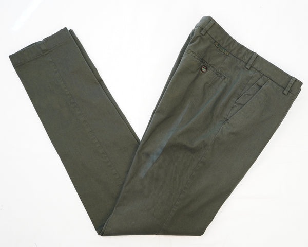 This kind of cotton trouser are one of the corner stones of every man's casual wardrobe, the slim fit chino. These are made in a slim cut and garment dyed and washed which give the trousers a beautiful and unique colour. These are the trousers that go with everything from t-shirts to jackets  98% Cotton 2% Elastan Color: Militare military green Button closure with zippered fly Changeable button in front Slanted front pockets and two back pockets Model: Morello  Article: xgab Made in Martina Franca, Italy