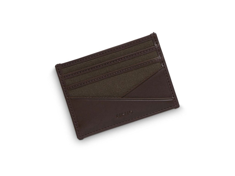 An everyday essential. Canvas/leather cardholder with 3 slots for credit cards on each side. Open pocket in the middle for bills, notes etc.  Measurements: L: 10  H: 7,5  W: 0,5cm Body: Tight-woven cotton canvas Fabric composition: CO 94% PU 4% PC 2% - 709 gr/rm Trimmings: Custom developed dark brown vegetable tanned full-grain bridle leather  Lining: 100% cotton in Army colour  Art. no. MS090112