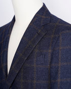 caruso full canvas Fully lined Unconstructed shoulder 3 roll 2 buttoning Side vents Notch lapel Patch pockets Composition: 72% wool, 25%coton, 3% cashmere Color: Navy and Brown Modello: Aida / ASM2JM304F Article: 505179 Colore: 0120 Made in Italy