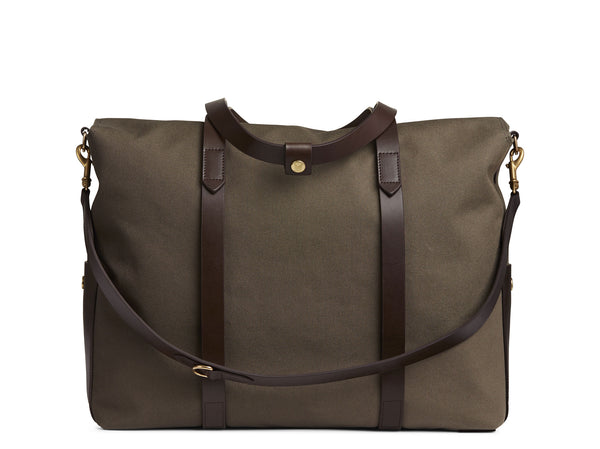 Measurements:  L: 46  H: 34  W:18 cm Body: Tight-woven cotton canvas Fabric composition: CO 94% PU 4% PC 2% - 709 gr/rm Trimmings: Dark brown vegetable tanned full-grain bridle leather  Lining: 100% cotton in Army colour Hardware: Solid brass with varnish protection Zipper: Hand Polished YKK Excella  Art. No. MS110110 travel bag, or bend flaps down for a large, open city tote bag.  A full-grain leather pocket on each gusset adds extra durability to the bottom corners