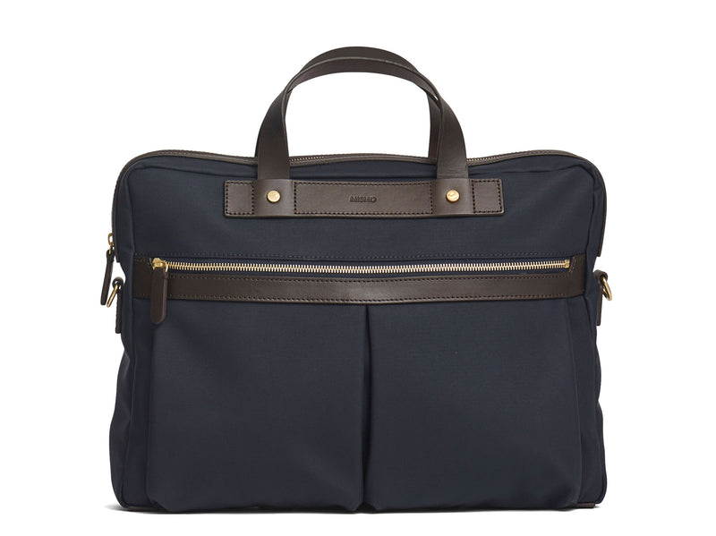 Measurements:  L: 39  H: 29  W: 8cm Body: Waterproof hard woven Italian nylon  Fabric composition: PA 42% CO 38% PU 20%  /  826g pr/m Trimmings: Dark brown custom developed vegetable tanned full-grain bridle leather Lining: 100% cotton in navy colour  Hardware: Solid brass with varnish protection  Zipper: Hand polished YKK Excella Art. No. MS461315 A softer and more casual counterpart to the M/S Briefcase, the M/S Office is designed with dual front pockets that zip open into one large compartment