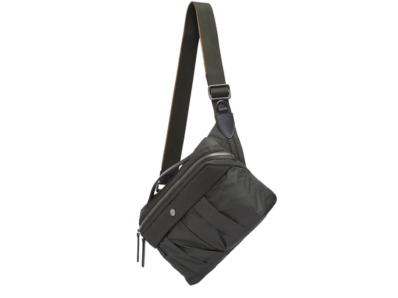 Measurements: L: 29 H: 20 W: 8cm Body: Italian double-bonded, lightweight nylon Fabric Composition: PA 47% PL 46% PU 7% / 373 gr/rm Trimmings: Black custom developed vegetable tanned full-grain bridle leather Lining: 100% nylon in beluga color Hardware: Gun-metal hardware Zipper: Hand Polished YKK Excella Ribbons: Italian, beluga & orange nylon, 40mm Art. No. MS784118 The functional sling bag is fitted with an easily adjustable two-tone nylon ribbon shoulder strap