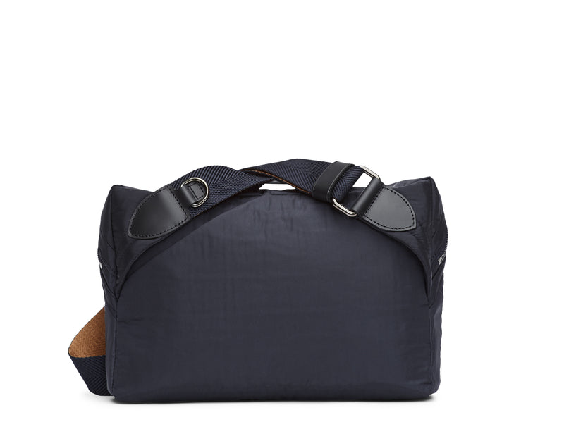 Measurements: L: 29 H: 20 W: 8cm Body: Italian double-bonded, lightweight nylon Fabric Composition: PA 47% PL 46% PU 7% - 373 gr./rm. Trimmings: Black custom developed vegetable tanned full-grain bridle leather Lining: 100% nylon in moonlight Blue Hardware: Gun-metal hardware Zipper: Hand Polished YKK Excella Ribbons: Italian, navy & orange nylon, 40mm Art. No. MS783918 sling bag is fitted with an easily adjustable two-tone nylon ribbon shoulder strap