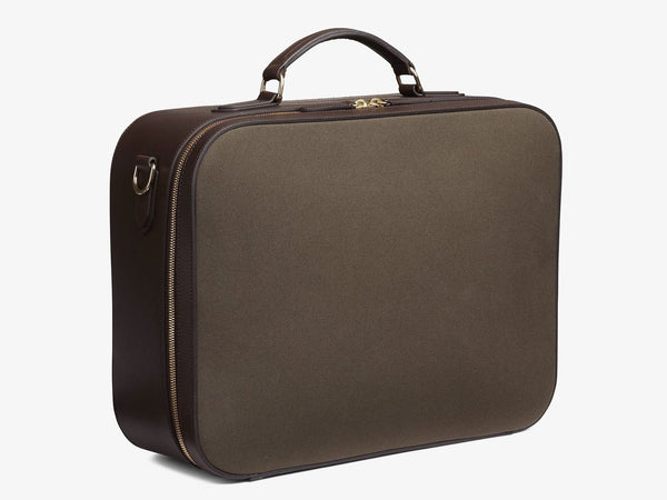 Measurements: L: 46  H: 35  W: 15 cm Material: Tight-woven cotton canvas Composition: CO 94%  PU 4%  PC 2%   / 709 g/m Trimmings: Dark brown, vegetable tanned full-grain bridle leather The M/S Suitcase fuses the contours of heritage travel bags with a minimalist design approach, equipping the carrier with a spacious and aesthetically pleasing bag. A sharp and clean-cut 48-hour suitcase