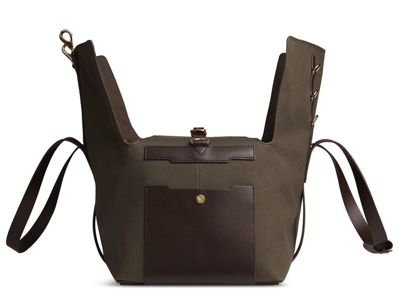 Measurements: L: 52  H: 25  W: 28(26) cm Body: Tight-woven cotton canvas Fabric composition: CO 94% PU 4% PC 2% - 709 gr/rm Trimmings: Dark brown custom developed vegetable tanned full-grain bridle leather Lining: 100% cotton in army colour  Hardware: Solid brass with varnish protection  Zipper: Hand polished YKK Excella Art. No. MS410114 Travel, gym, tennis - wherever life's adventures  the M/S Supply a great addition. Elongated handles make easy to carry bag by hand, hung over shoulder worn rucksack mismo
