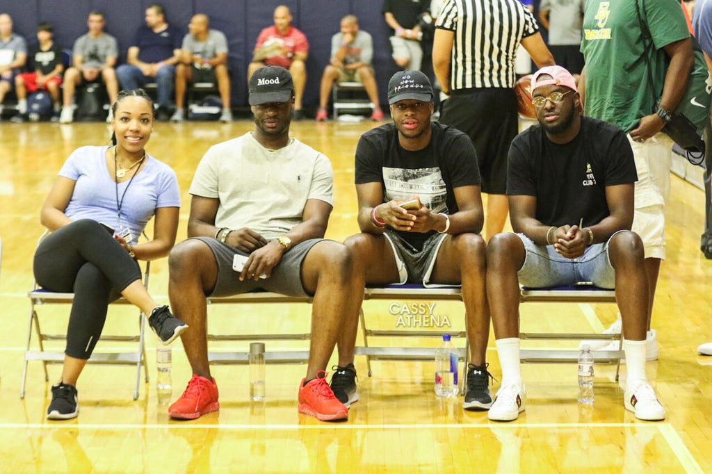 Alexis Robinson sits with the Mudiay brothers, Jean-Michel, Emmanuel  and Stephane