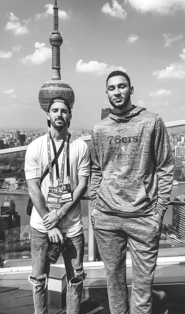 Philadelphia 76ers photographer Alex Subers stands with NBA player Ben Simmons