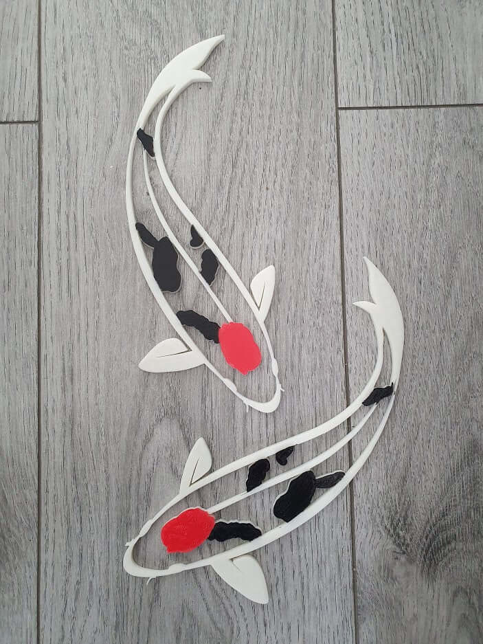 Red and black Koi fish wall decor