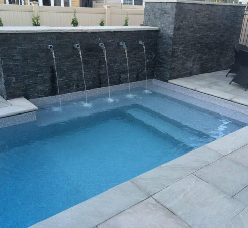 Swimming Pool Vinyl over steel bench VOS and steps in custom vinyl pool. Pool Products Canada is the top swimming pool builder contractor in Colingwood Ontario.