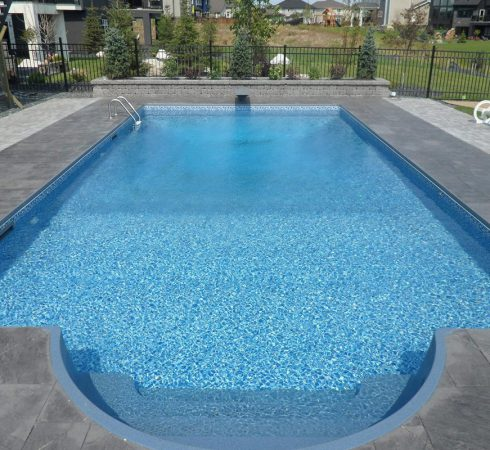 Fiberglass in ground pool steps. We build the best swimming pool in Collingwood and Blue Mountain.