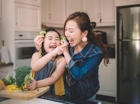 mom-daughter-laughing-kitchen