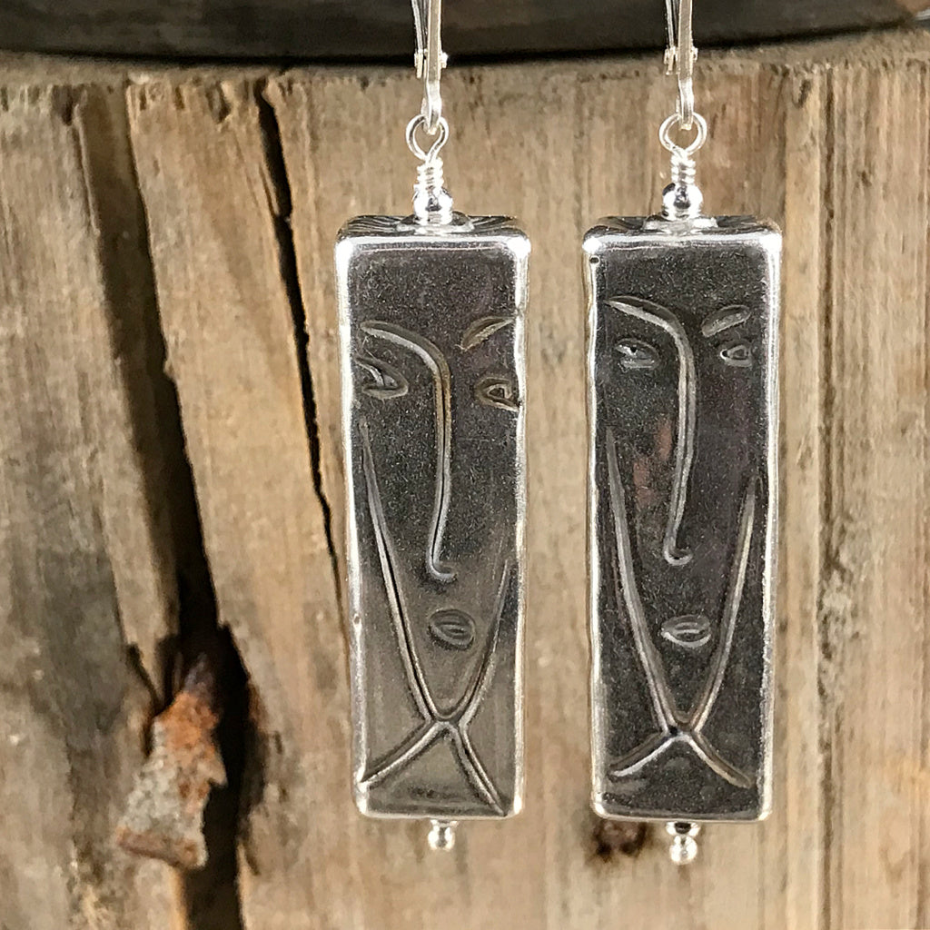 "This Suzie Q Studio earring collection features handmade earrings created by Suzie Q Studio artisans. These earrings are like a couple of Picasso-style paintings dancing from your ears! And because these über-cool beads are made of ""electroformed"" sterling silver, they're incredibly light and easy-to-wear."