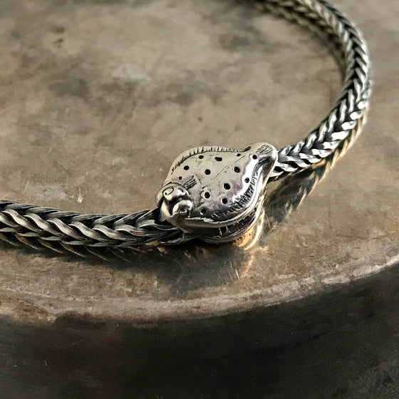 Suzie Q Studio has a treasure vault full of Rare and Retired Trollbeads... and we're making them available to you. The FLOUNDER bead left the collection in 2010. A funny, elliptical, flat fish with a crooked mouth and eyes on the side… A fish of many guises.