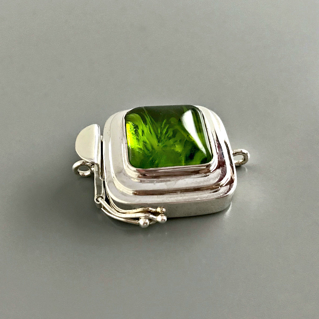 This Suzie Q Studio custom box clasp was handcrafted with a juicy, rich, lime-green vintage glass cabochon and set in a substantial amount (more than average) of sterling silver for a statement-making piece of jewelry.